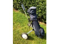 Set of golf clubs with trolley.vario
