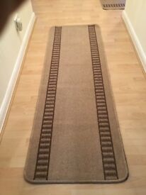 Two brown and beige carpet runners.