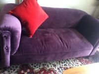 This is a beautiful settee upholstered in purple velvet