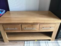 Solid oak coffee table with 6 drawers. Excellent condition.