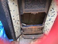 Cast Iron and tile panelled vintage fire surround. Very heavy, needs some tlc.