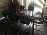 Black Glass Dining Table Including 6 Faux Leather Chairs
