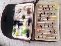 Fishing flies in a wick hams case.