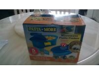 pasta n more pasta microwave cooker.never used still in packaging.