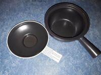 Single handed black clay pot - goes on the hob and in the oven - unused