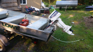 14 ft Lowe fishing boat, 8 horse two stroke and trailer