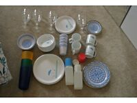a set of plates, bowls, cups and saucers for camping.