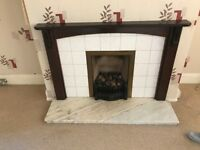 Gas fire with marble bottom and wooden frame