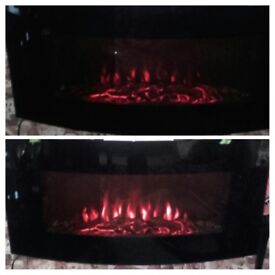 Black curved front remote controlled electric fire.