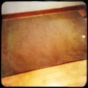 Small golden brown short pile rug/carpet 62X91 inches