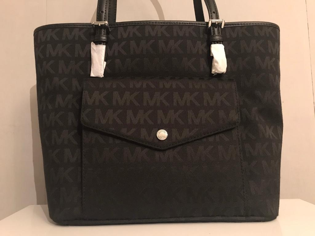 Michael Kors black monogram tote bagin Islington, LondonGumtree - This is a Brand new with tags Authentic Michael Kors bag. If you Are interested please reply to this add