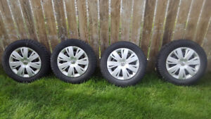 4 - 215/60/r16 Winter Tires on Rims w/ VW hubcaps