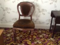 A pair of Victorian ballooned back chairs
