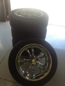 20 inch chrome rims with near new tires