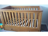Cot bed in solid wood. Originally from mothercare. Less than 2 years old