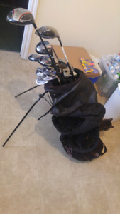 Full set of clubs with carrying bag. Lots for tees and balls