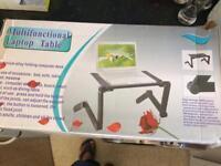 Multifunctional laptop table