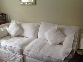 Sofa with large matching foot stool plus spare set covers