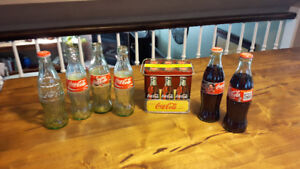 Coca Cola collector tin and bottles