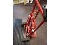 Amazing 21st century sack truck, red in colour bold in features. Lifting builder trade tools bargain