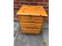 Solid pine three drawer bedside chest of drawers