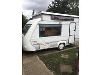 Rapido 32t poptop caravan with awning