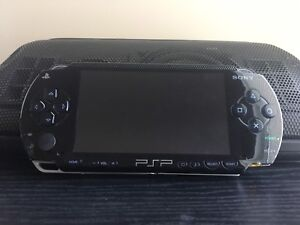 Psp 1000 with two movies