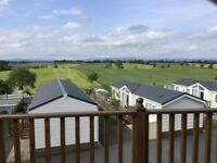 Rare chance to buy 2 bed lodge at Todber Valley site with secluded position and spectacular views.