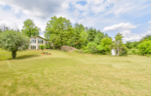 Beautiful bungalow on a lovely 1.5-acre lot!
