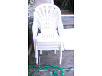 White plastic, Garden Table and 4 stackable chairs