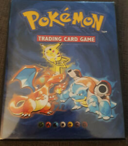 1999 Pokemon card album with cards