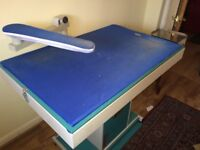 Dry Cleaners ironing board and steam iron and boiler