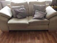Two big comfy cream sofas