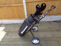 Golf trolley, clubs and balls