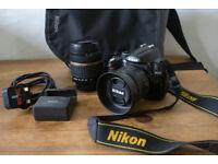 Nikon d5000 + 35mm 1.8 g lens + extras