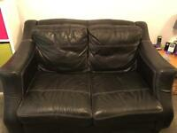 2 x Large 2 Seater Leather Sofas plus Storage Foot Stall