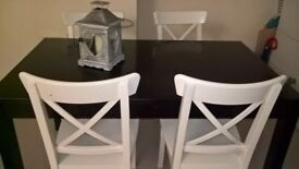 Lovely Black Table and White chair set. Ikea Bjursta. Good condition. Very sturdy. Extendable table