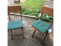 Two wooden folding garden chairs