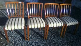 Four beautifully upholstered dining chairs