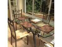 Glass designer dining table and 4 chairs