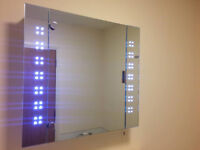 LED mirror cabinet with shaver point