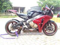 Crimson & black beauty with one off moto grafix paint protect scheme.