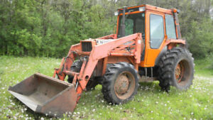 Kubota 80 Hp tractor with loader and bucket M7950DT 4 x 4 PTO