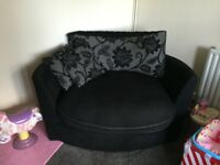 Black and grey love swivel chair and 3 seater sofa