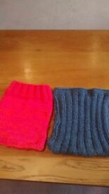 Hand knitted tablet sleeves.