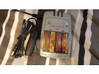 Uniross x-press battery charger. charges AA or AAA battery's Ni-MH an Ni-Cd