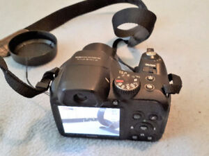 $60 for Camera, 8 GB SDHC card, rechargeable batteries & charger