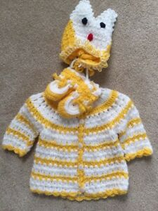 Handmade baby sweater with booties and fox hat
