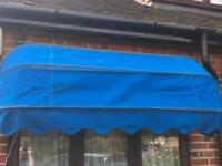 2 wall mounted, blue sun canopies - £30 each or £50 for both