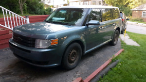 2010 Ford Flex SEL Awd.  Fixer upper.